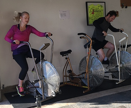 people working out on stationary bikes